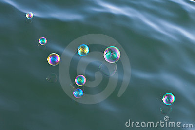 Shiny soap-bubbles over water