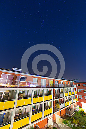 Shiny stars over apartment building