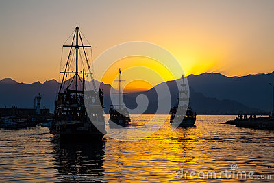 Ship in bay at sunset.