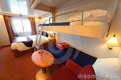 Ship cabin with window, bed and two children beds