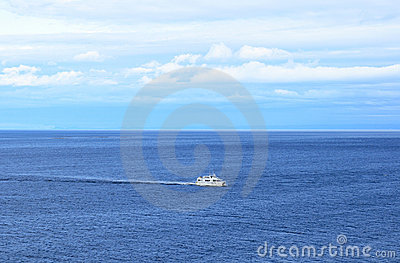 Ship in the calm blue sea