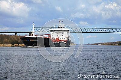 Ship with cargo on the Kiel Canal, Germany.