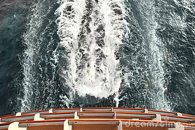Ship deck and trail with waves and foam in ocean