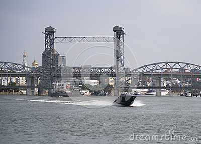 The ship floats under a drawbridge from the south
