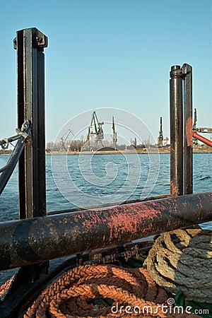 Ship granary ma cranes in port.