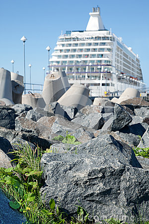 Ship near  stones grass concrete blocks