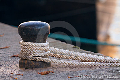 Ship rope tied to a harbor