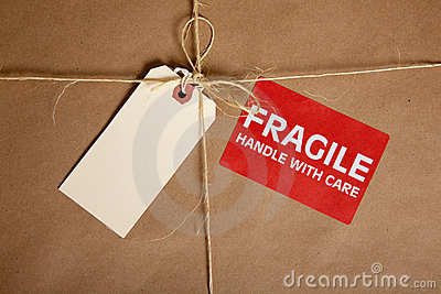 A Shipping box with a blank tag and a Fragile