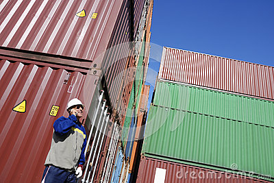 Shipping containers and dock worker