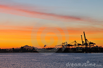 Shipping crane and mt. baker at dawn