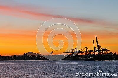 Shipping crane and mt. baker at dawn