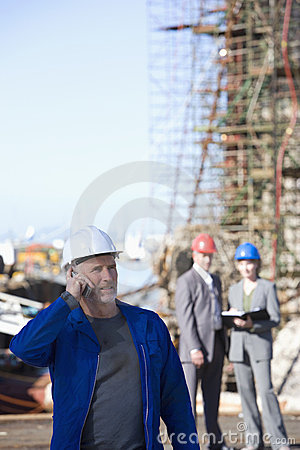 A shipping engineer talking on phone
