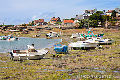 Ships by ebb-tide in harbor of  Brittany