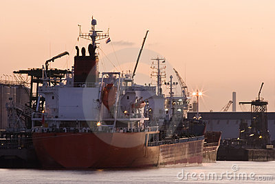 Ships in port at red sunrise