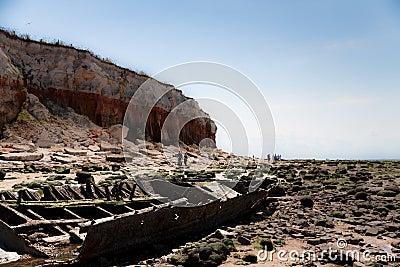 Shipwreck by cliffs