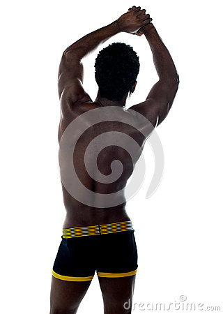 Shirtless african fit guy. Back pose