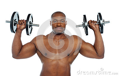 Shirtless african male holding dumbbells