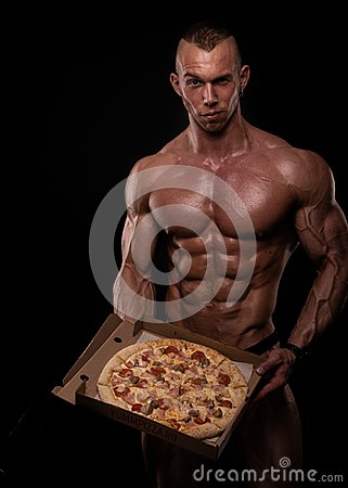 Free Shirtless Athlete With Pizza Royalty Free Stock Images - 124111819