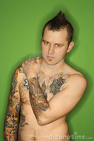 Shirtless Caucasian man with tattoos.