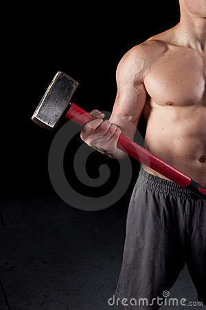 Shirtless guy holding a sledgehammer