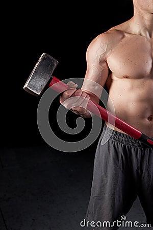 Shirtless guy holding a sledgehammer