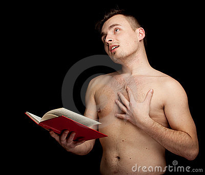 Shirtless man reading book
