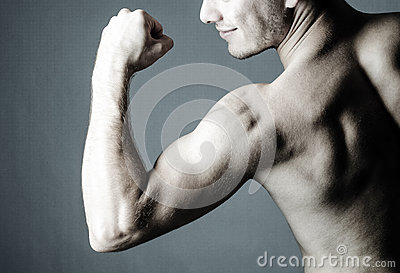Shirtless man showing his biceps