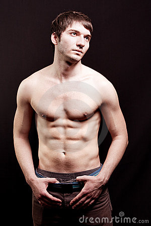 Shirtless young man with sexy abdomen
