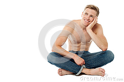 Shirtless young man thinking something