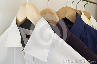 Shirts on wooden hangers