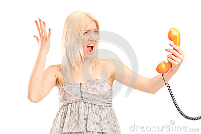 A shocked blond woman screaming on a phone