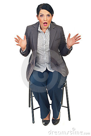Shocked business woman on chair