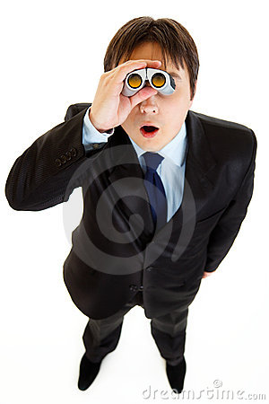 Shocked businessman looking through binoculars