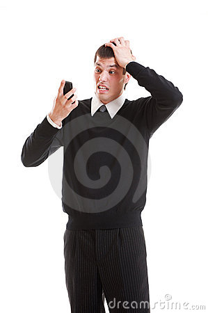 Shocked businessman looking at mobilephone