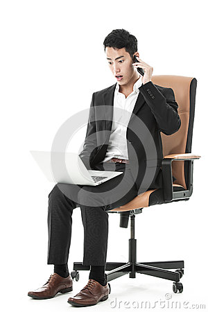 Shocked businessman multitasking
