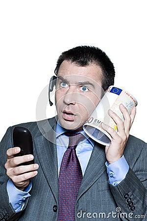shocked businessman phone and money box