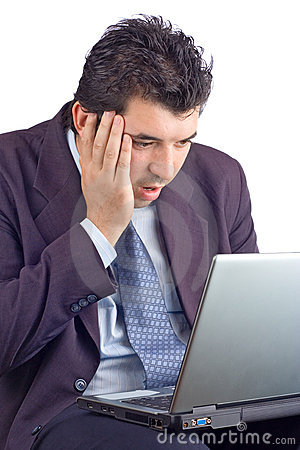 Shocked businessman working on a laptop