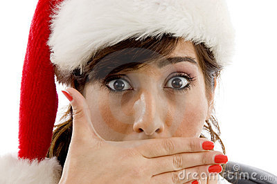 Shocked female attorney wearing christmas hat