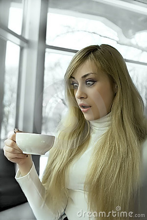 Shocked girl looking in the cup