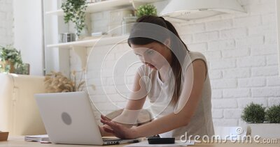 Shocked girl student using laptop stressed about online computer problem stock footage