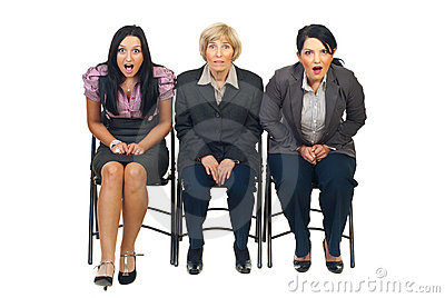 Shocked group of businesswomen