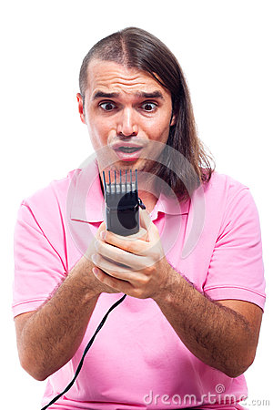 Shocked half bald man with hair trimmer