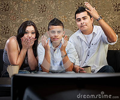Shocked Hispanic Family Watching TV