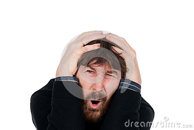 Shocked man with a beard holds hands head
