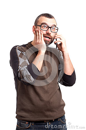 Shocked man with beard talking by cell phone