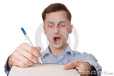 Horrified man signing document