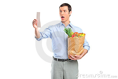 Shocked man looking at store receipt