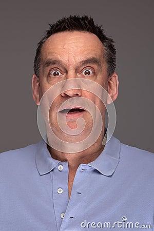 Shocked Scared Man on Grey Background