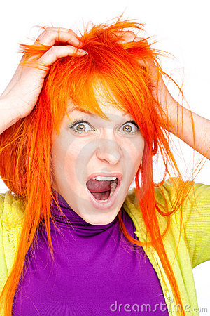 Shocked screaming woman holding red head
