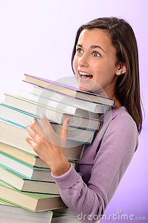 Shocked student girl carry stack of books